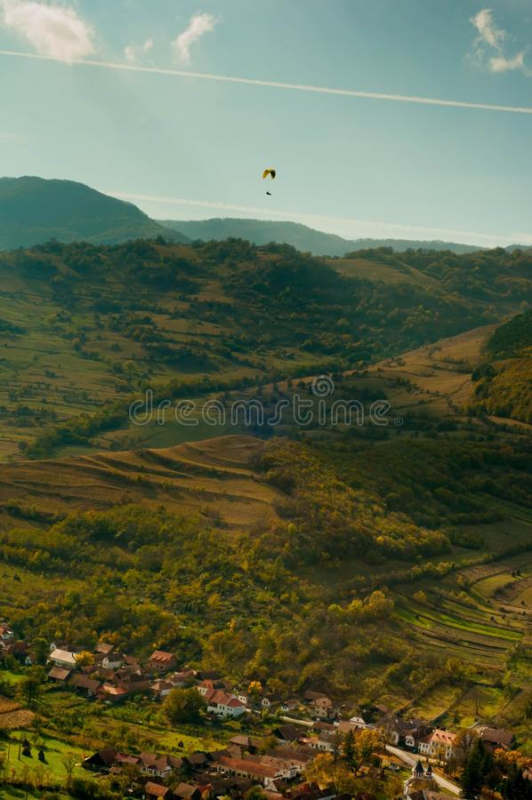 Paragliding over the mountains. Paragliding on a sunny day in the mountains royalty free stock images