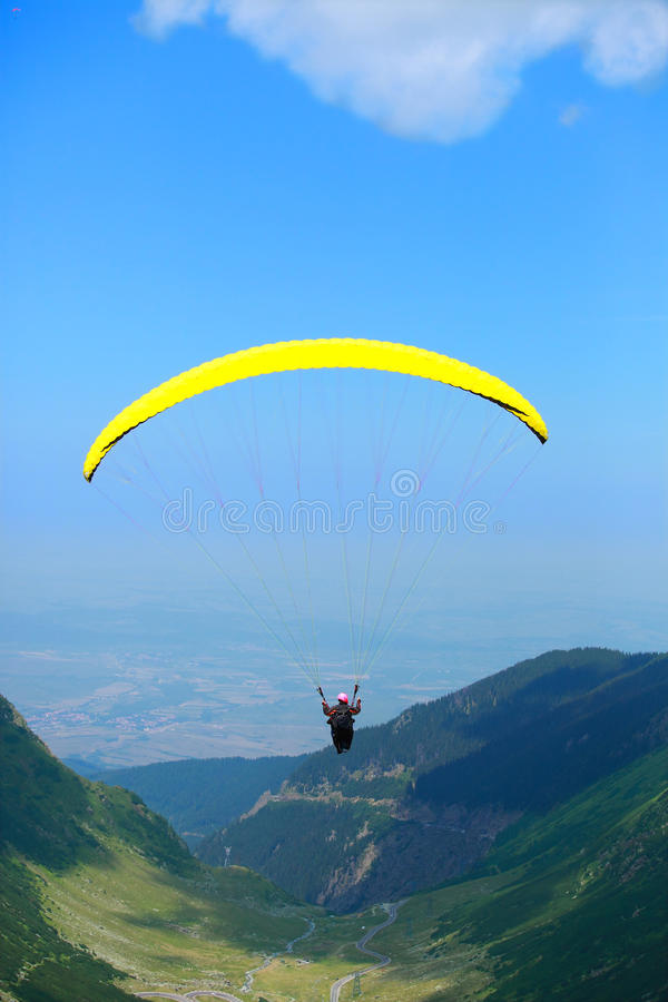 Paragliding over valley and mountains stock photo
