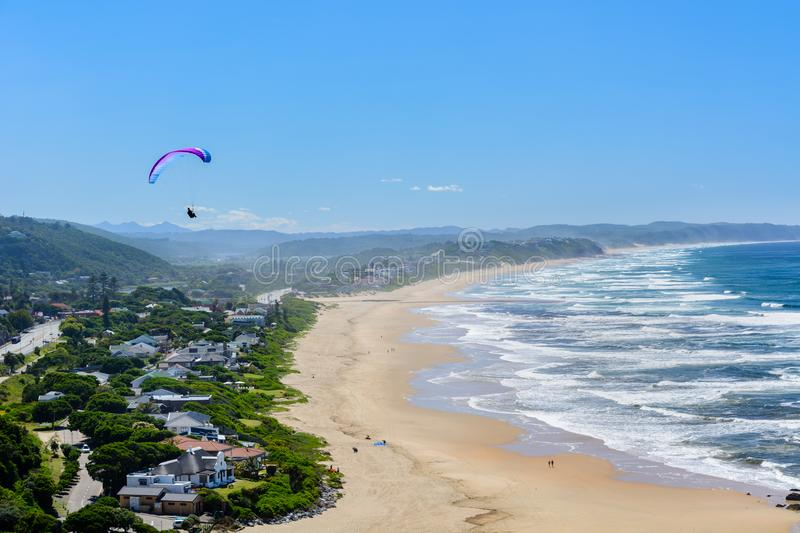 Paragliding over Wilderness beach on the Garden Route, South Africa royalty free stock photos