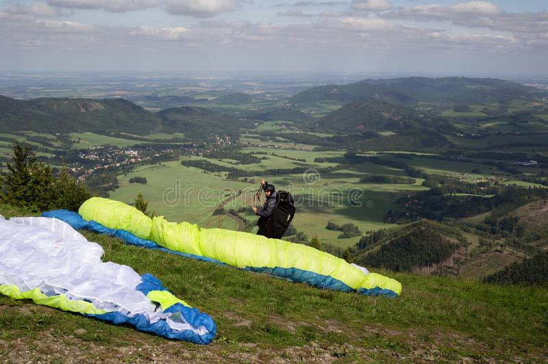 Paragliding - paraglider is preparing for launch, takeoff and start. royalty free stock photo