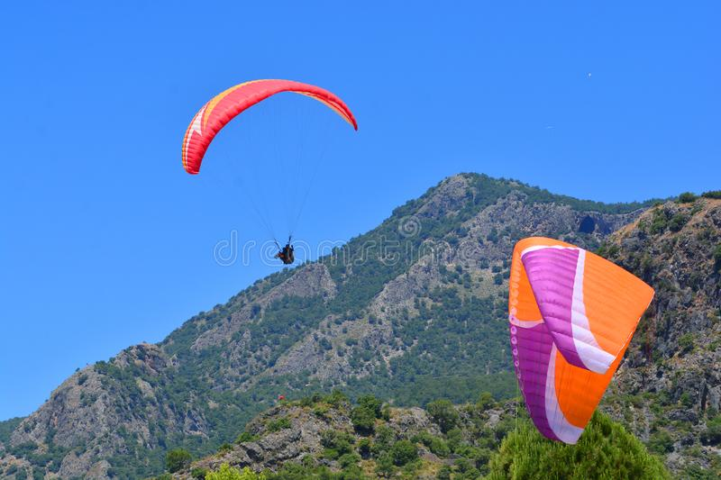 Paragliding. Paragliders On A Blue Sky And Mountains ...