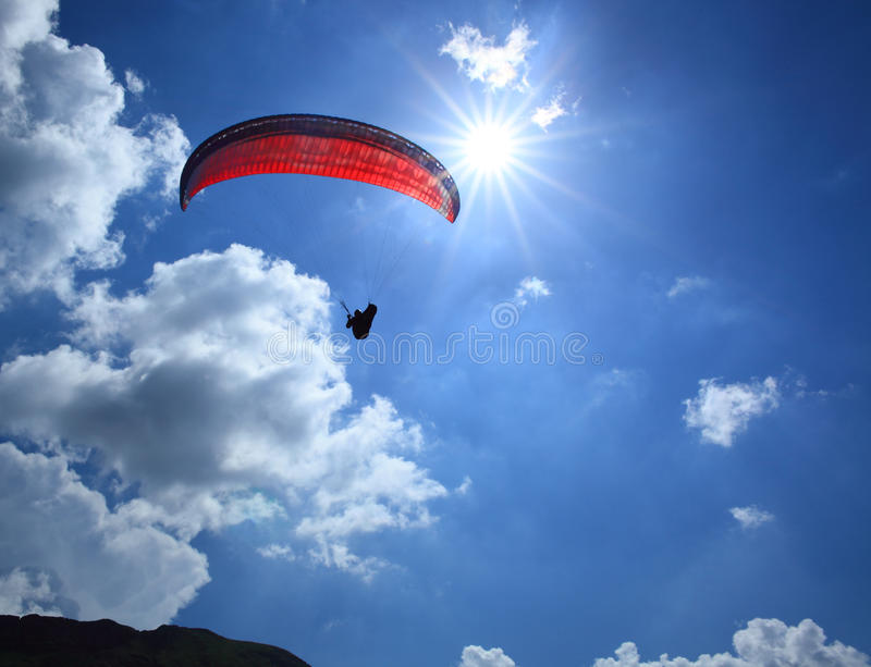 Paragliding on a sunny day stock photos