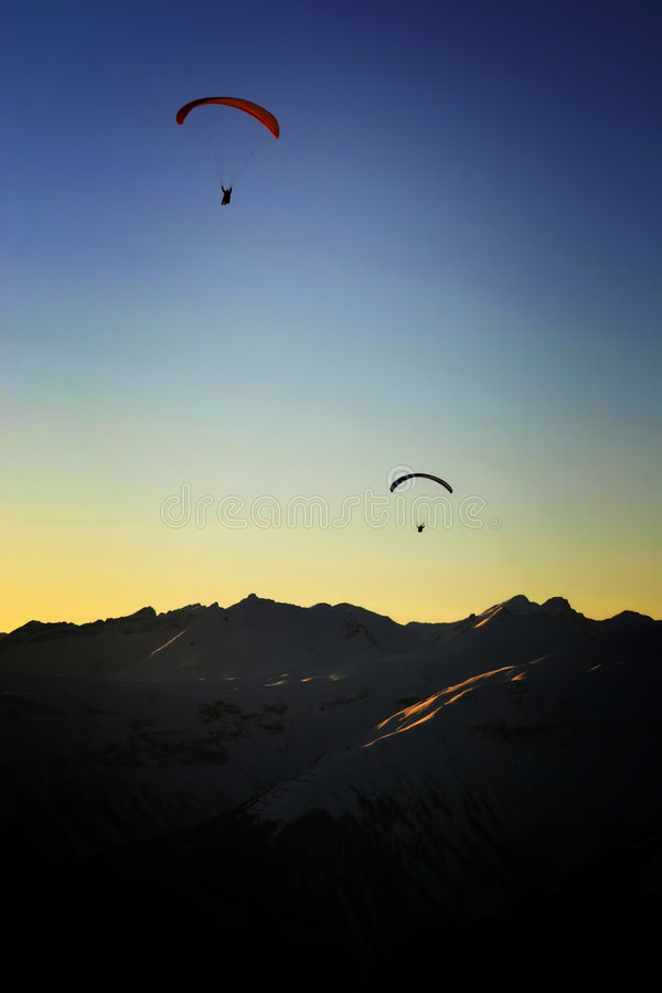 Download Paragliding Into The Sunset Stock Image - Image of altitude, emotional: 524875