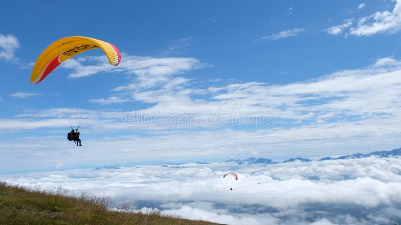 Paragliding take-off into the clouds royalty free stock image