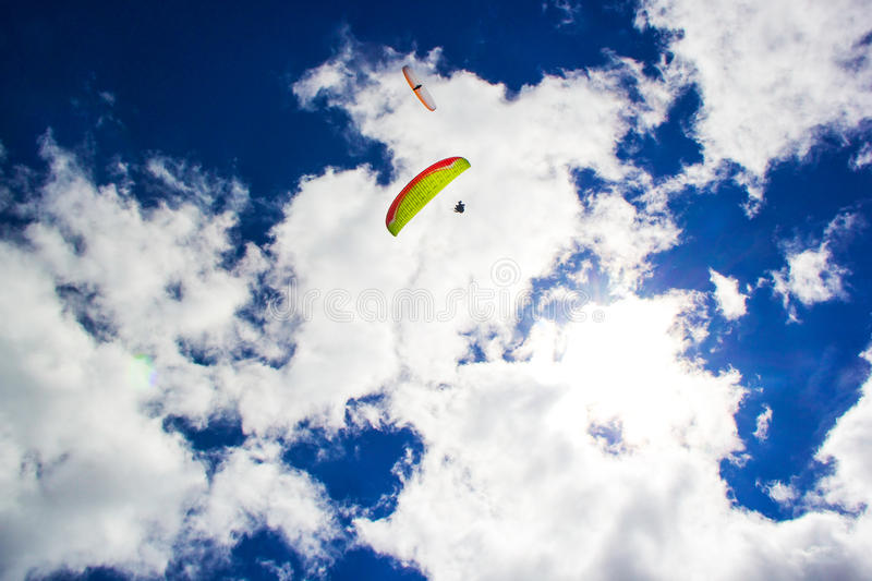 Paragliding. Two gliders flying in a blue sky royalty free stock photography