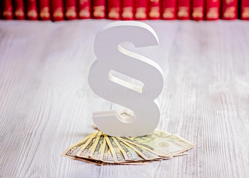 Paragraph symbol and american dollars in court library. Bribe and law concept royalty free stock photography