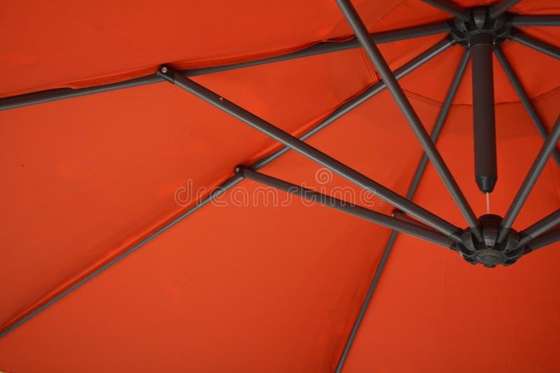 Paraguas anaranjado fotos de archivo