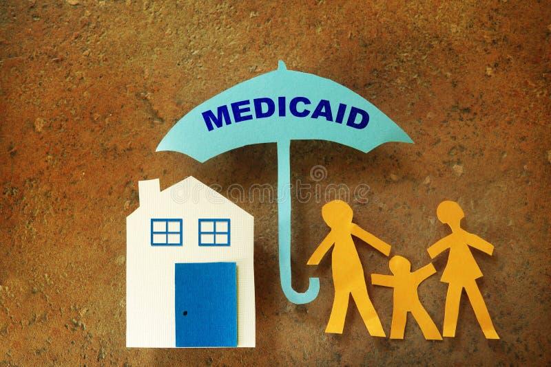 Paraguas de Medicaid de la familia imágenes de archivo libres de regalías