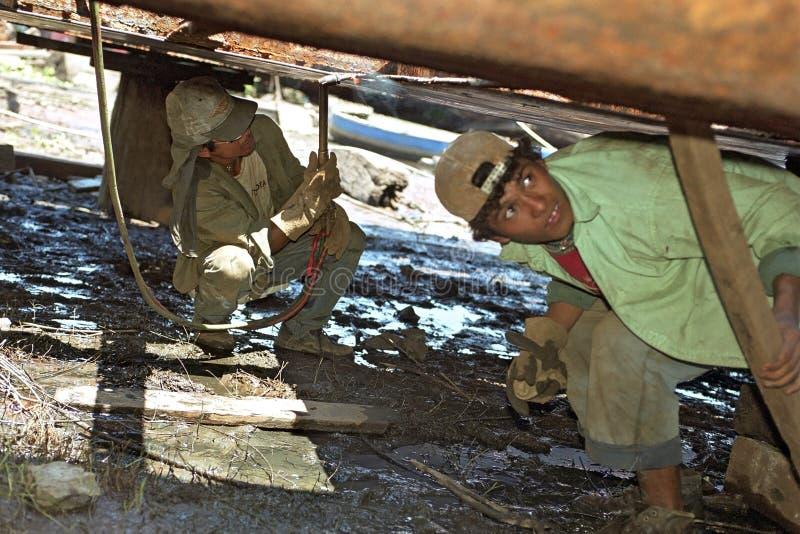 Paraguayan dockers working at a shipyard royalty free stock image