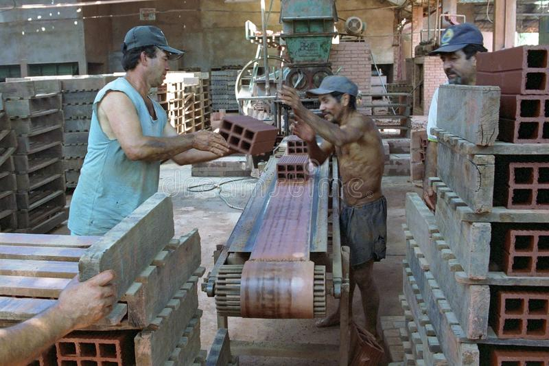 Paraguayan workerss at work in bricks factory royalty free stock image