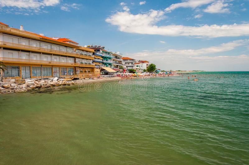 Paralia resort city on Aegean sea coast full of hotels, apartments, beaches, tourists and various attractions. Paralia, Greece - June 13, 2013: Paralia resort stock image