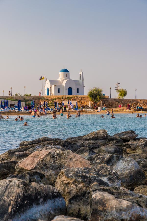 A typical view in Paralimni Cyprus. Paralimni Cyprus. 16 August 2019. A view of the mediterranean sean and agios nikolaos, st Nicholas church in paralimni in stock photo
