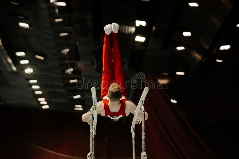 parallel bars male gymnast stock images