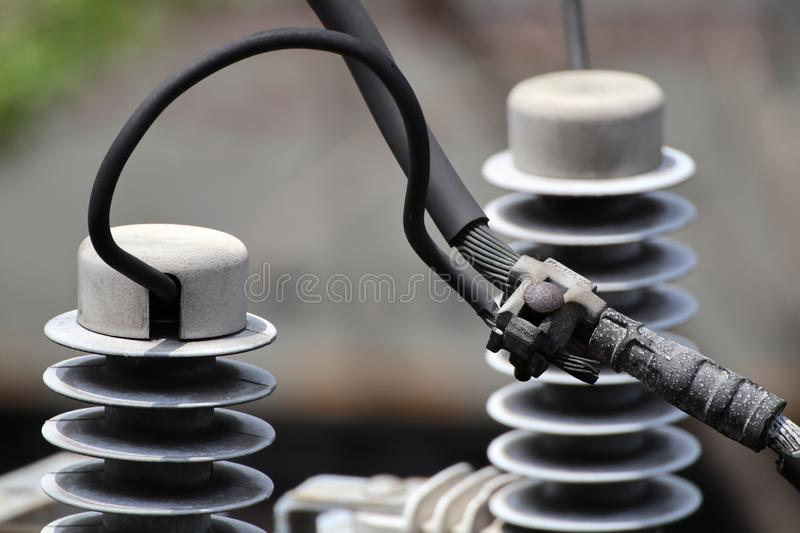 Parallel Groove Clamp connecting between Power Line and Surge Arrester stock photo
