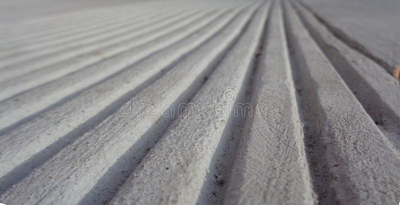 Parallel Lines in Concrete Toward a Horizon Optical illusion royalty free stock photo