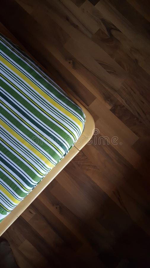 Parallel lines of fabric and floor royalty free stock photo