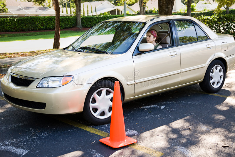 Parallel Parking. Teen girl learning to parallel park a car stock images