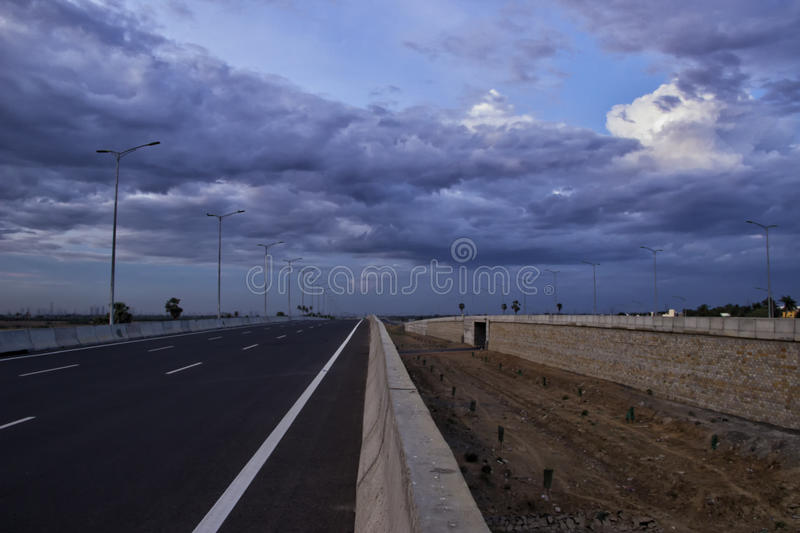 Parallel road. S leading the way, Bypass road stock photography