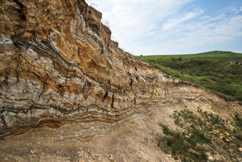 Parallel sedimentary layers on the coast of the sea of Azov. In Crimea stock image