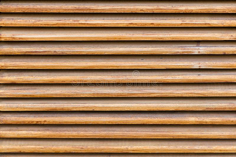 Parallel wooden slats texture. Wooden blinds, as an element of decor. Interior ventilation. Wood background, close up stock image