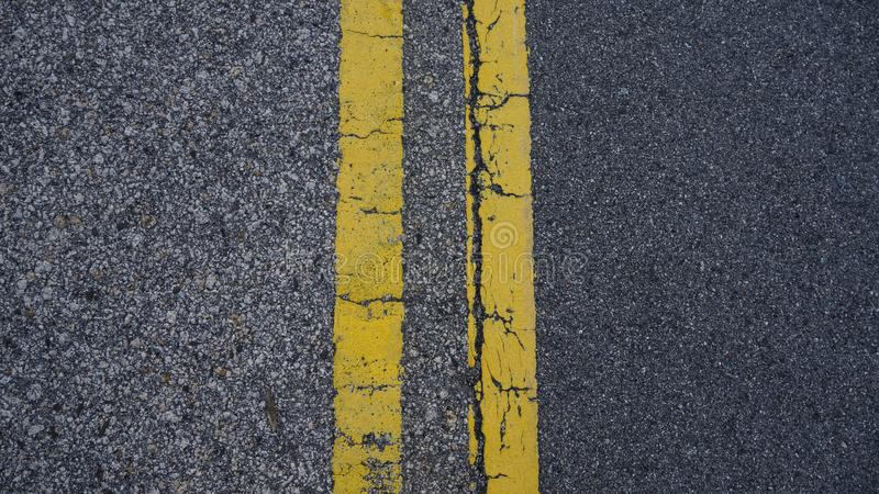 A parallel yellow lines on the floor stock photo