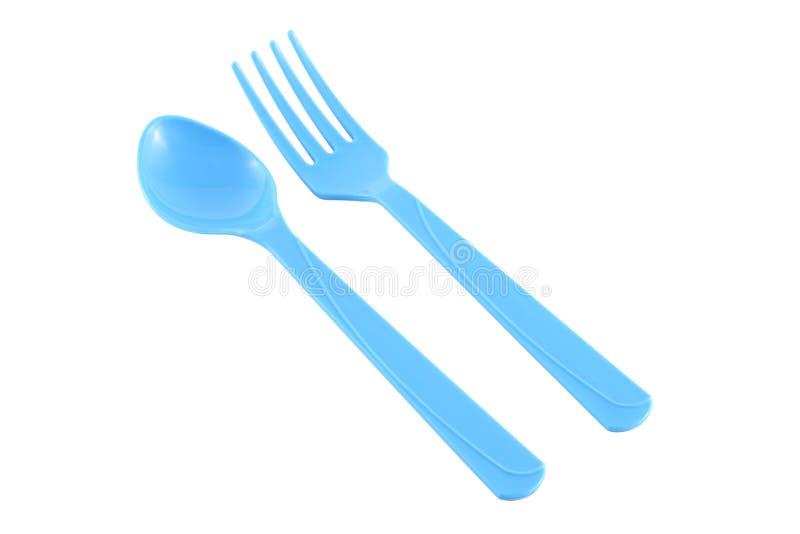 Paralleler blauer Plastiklöffel und Gabel lizenzfreies stockfoto