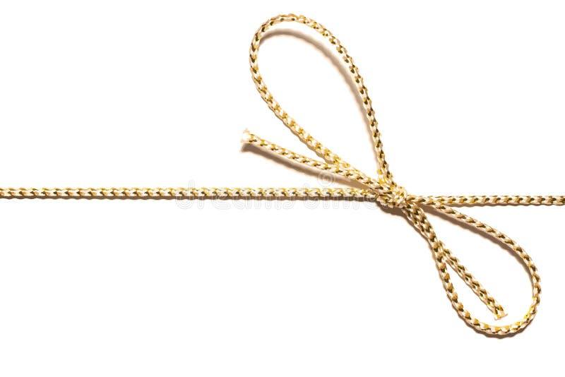 Parallelo dorato della corda del raso da incorniciare con l'involucro annodato del nastro del regalo dell'arco per regalo di Nata illustrazione di stock