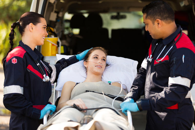 Paramedic comforting patient royalty free stock photography