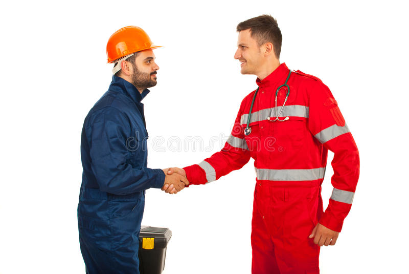 Paramedic and constructor worker meeting. And giving hand shake isolated on white background stock photography