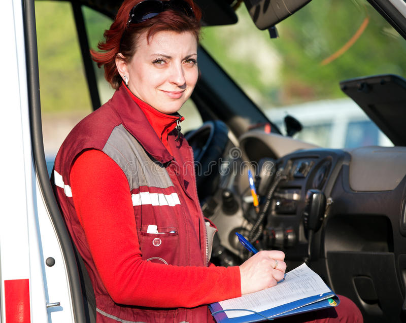 Paramedic female writing in emergency car royalty free stock images