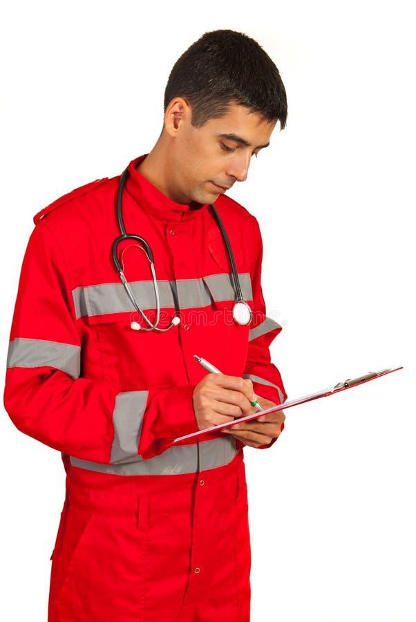 Paramedic giving prescription. Paramedic man giving prescription isolated on white background stock photo