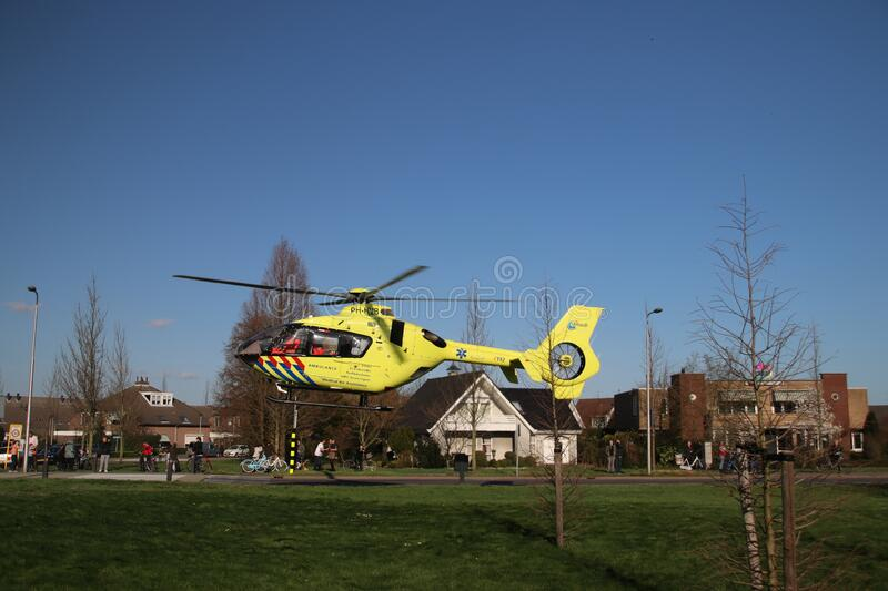 Paramedic helicopter landed on small grass field for medical emergency incident in Zevenhuizen stock images
