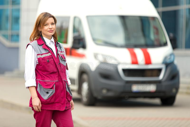 Paramedic medical technician at emergency car background stock photo