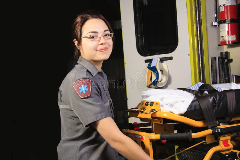 Paramedic. A paramedic person with his stretcher close to the ambulance royalty free stock photos