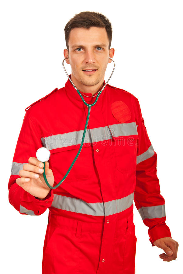 Paramedic showing stethoscope. Paramedic man showing stethoscope isolated on white background royalty free stock photography