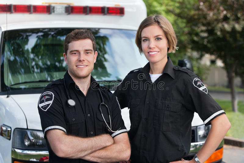 Paramedic Team. Portrait standing in front of ambulance stock image