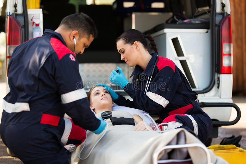 Paramedic team examining pateint royalty free stock photography