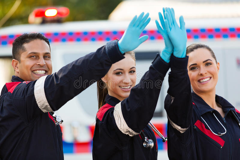 Paramedic team high five stock photography