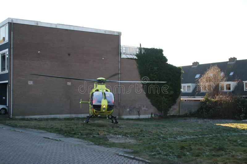 Paramedic trauma helicopter PH-ELP or Lifeliner 2 leaving scene of incident in Waddinxveen the Netherlands. stock photo