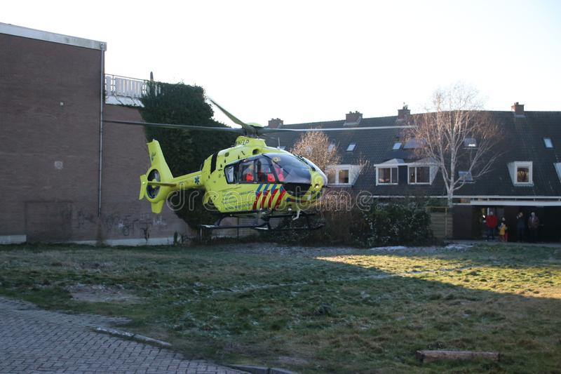 Paramedic trauma helicopter PH-ELP or Lifeliner 2 leaving scene of incident in Waddinxveen the Netherlands. royalty free stock photos