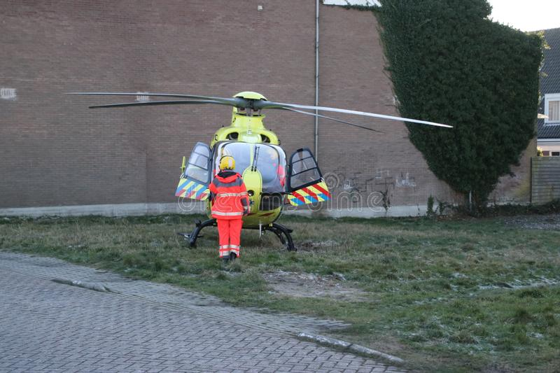 Paramedic trauma helicopter PH-ELP or Lifeliner 2 leaving scene of incident in Waddinxveen the Netherlands. royalty free stock photography