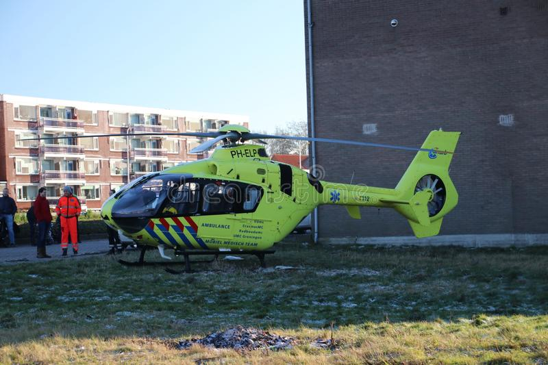 Paramedic trauma helicopter PH-ELP or Lifeliner 2 leaving scene of incident in Waddinxveen the Netherlands. royalty free stock images