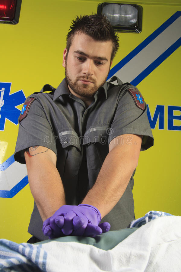 Paramedic who make a cardio-pulmonary royalty free stock image