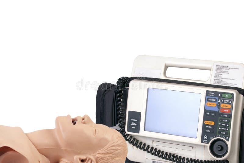 Paramedicinskt utbildande begrepp, f?rsta hj?lpenkurs Aed-defibrillator och en cpr-utbildningsattrapp Yrkesm?ssig modern medicins arkivbilder
