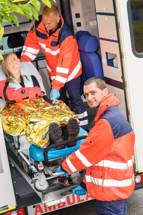 Download Paramedics Helping Woman On Stretcher In Ambulance Stock Photo - Image: 26904398
