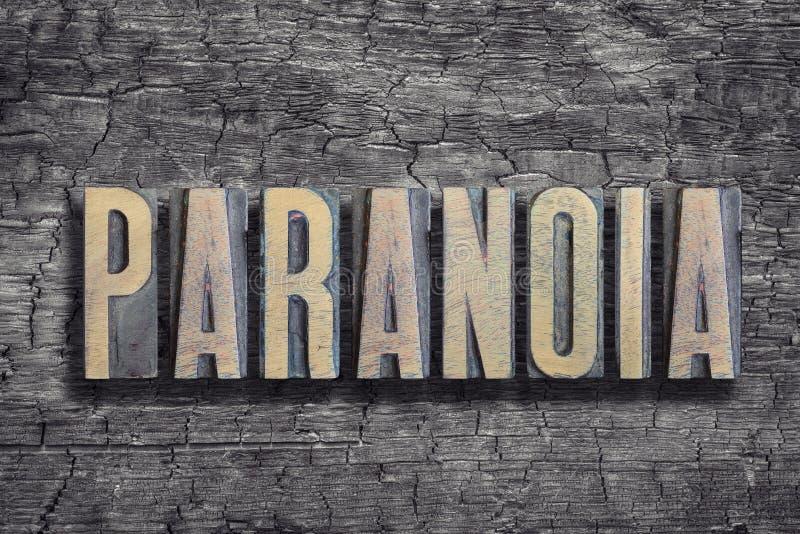 Paranoia word burned wood royalty free stock photography