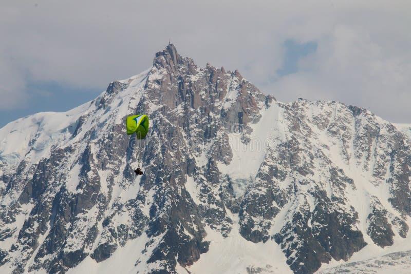 Parapenter near Aiguille du Midi, Mont Blanc massif stock images