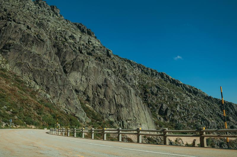 Parapet on edge of road passing through rocky landscape royalty free stock photo