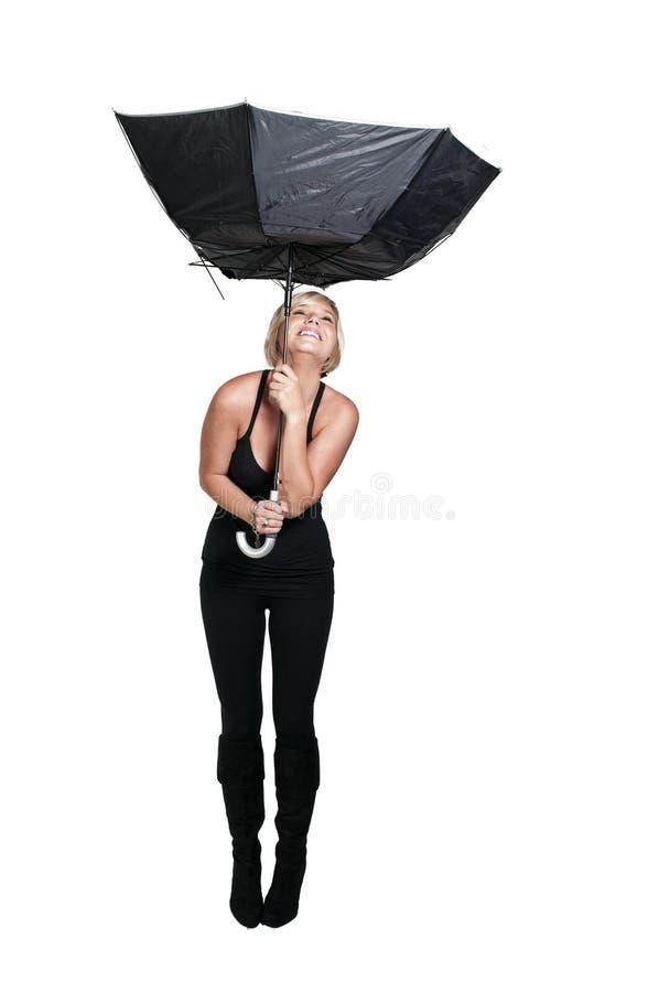 Parapluie de fixation de femme photographie stock