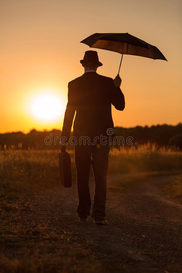Paraply i solnedgång 2 arkivbilder